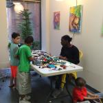 """Parents and children having """"family time"""" with LEGO at Make-It Springfield in 2016."""
