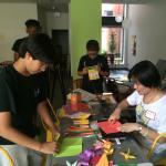 UMass LARP graduate student Yanhua Lu was teaching elementary students how to make origami at Make-It Springfield in 2016.